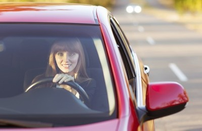 girl traveling by car smiling